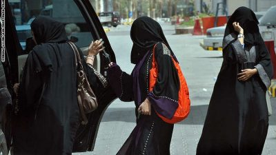 RIYADH - MAY 26: Saudi women get into the backseat of a car in Riyadh on June 14, 2011, three days before a June 17 nationwide campaign by Saudi women who are planning to take the wheel in protest against a driving ban which is unique to the kingdom that applies a strict version of Sunni Islam. Photo by FAYEZ NURELDINE/AFP (Photo credit should read FAYEZ NURELDINE/AFP/Getty Images)